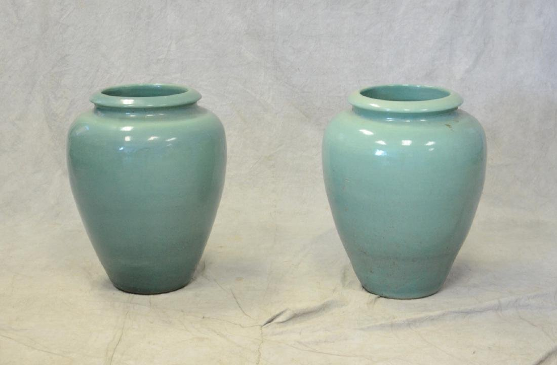 Pair turquoise pottery planters