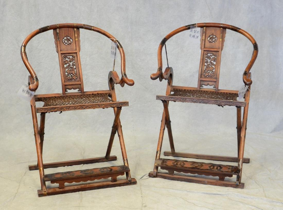 Pair Asian style carved Rosewood folding chairs
