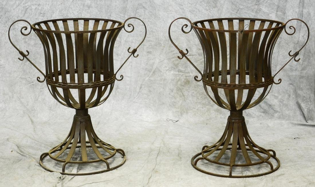 (2) Iron handled basket planters