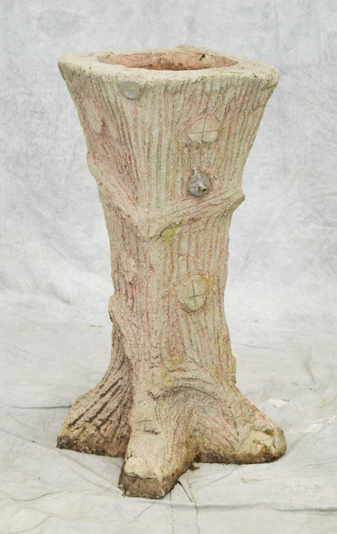 Cast stone tree trunk form planter
