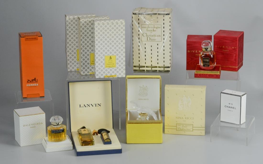 12 Designer perfumes & talcs in original boxes