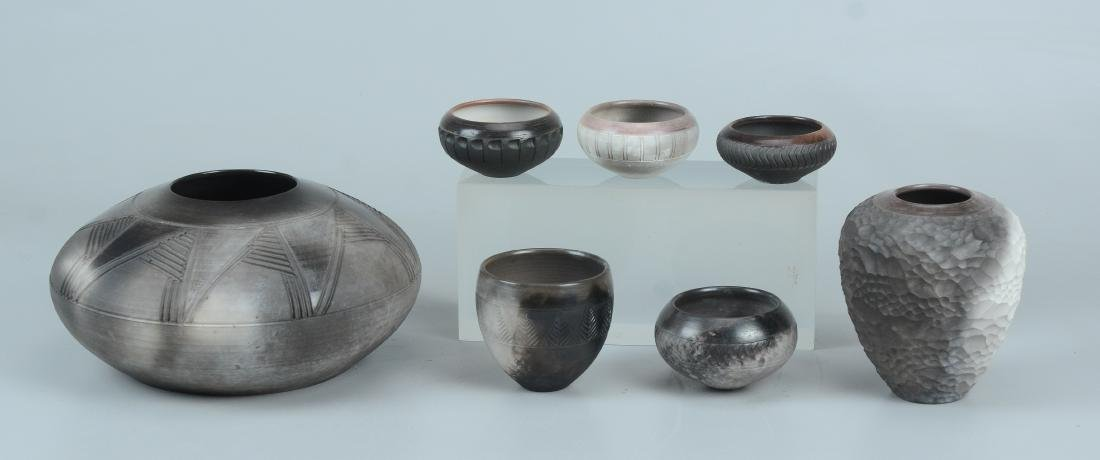 7 signed art pottery bowls