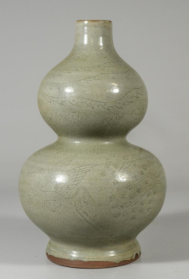 Chinese double gourd vase with incised decoration