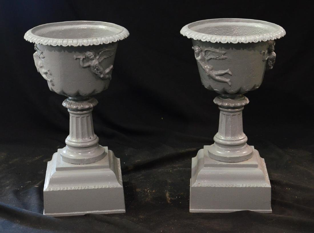 Pr cast iron planters, the bowls decorated with angels