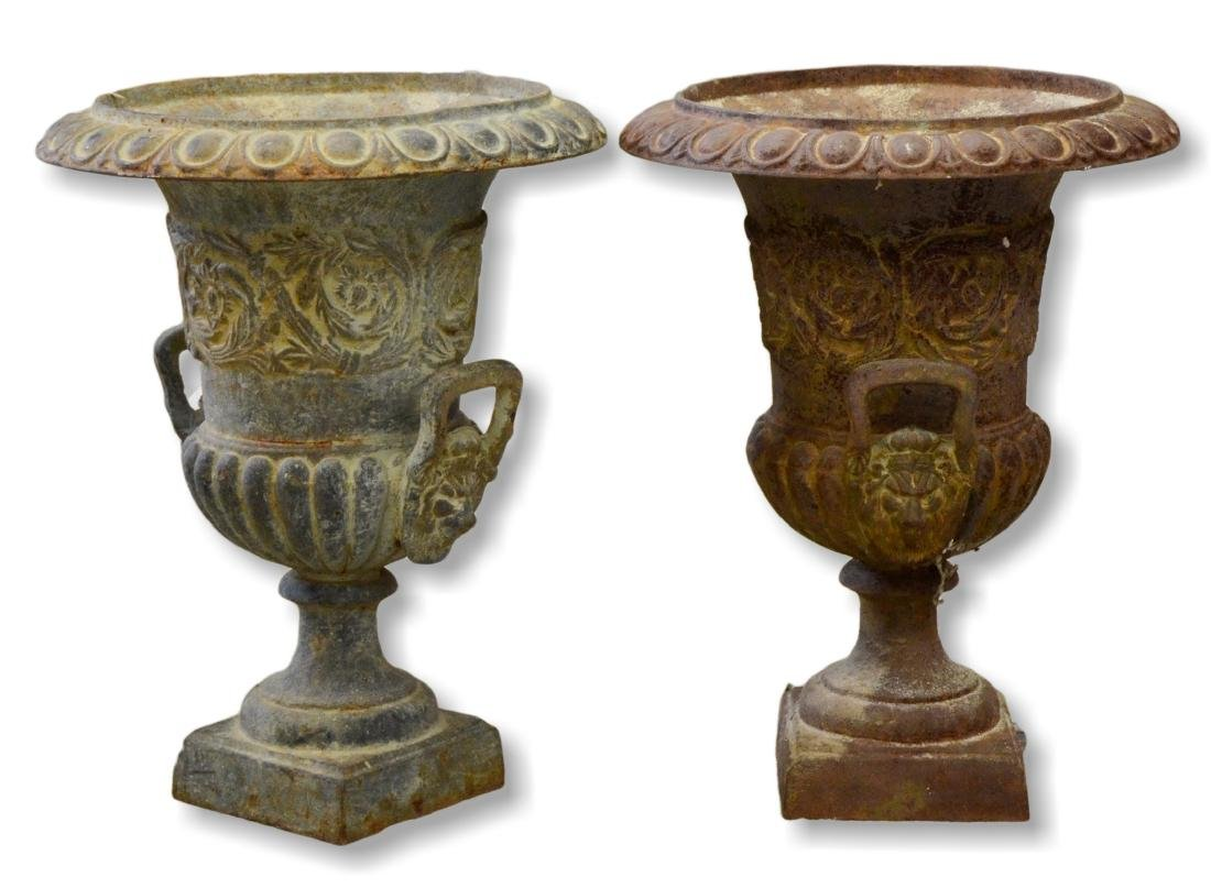 Pair cast iron urns, lion head handles