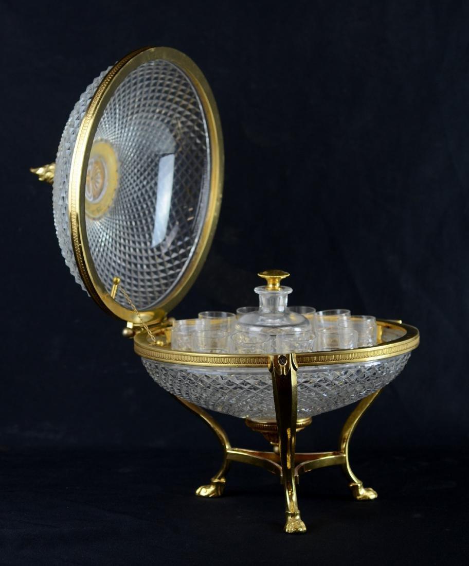 Round gilt brass mounted cut crystal tantalus