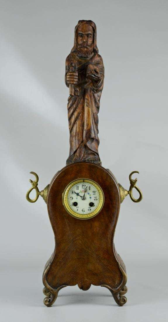 Figural carved French mantle clock