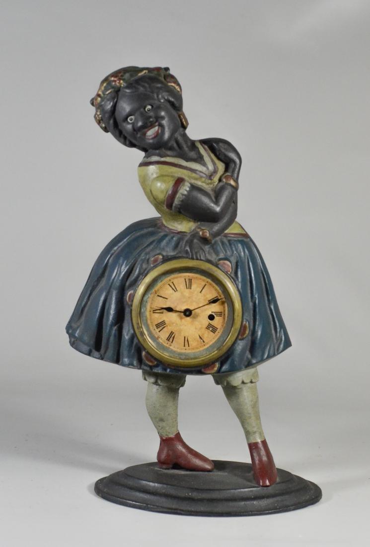 """Cast iron Topsy """"Blinking Eye"""" Clock, c 1875-85"""