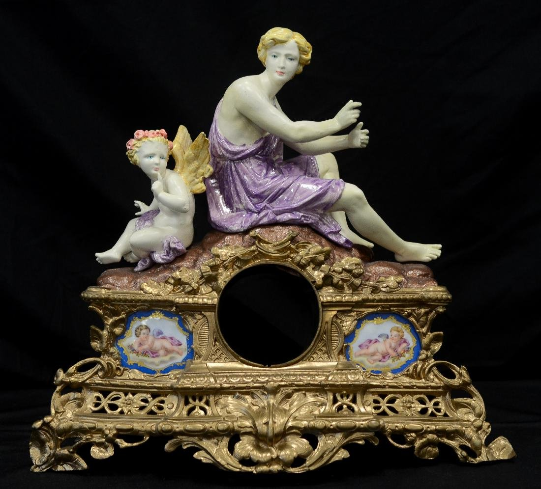 Painted spelter clock case, woman & cherub
