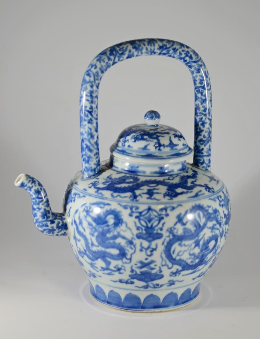 Chinese blue and white teapot with dragon decoration
