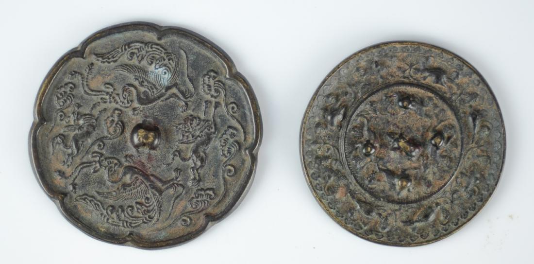 (2) Archaic style bronze mirrors