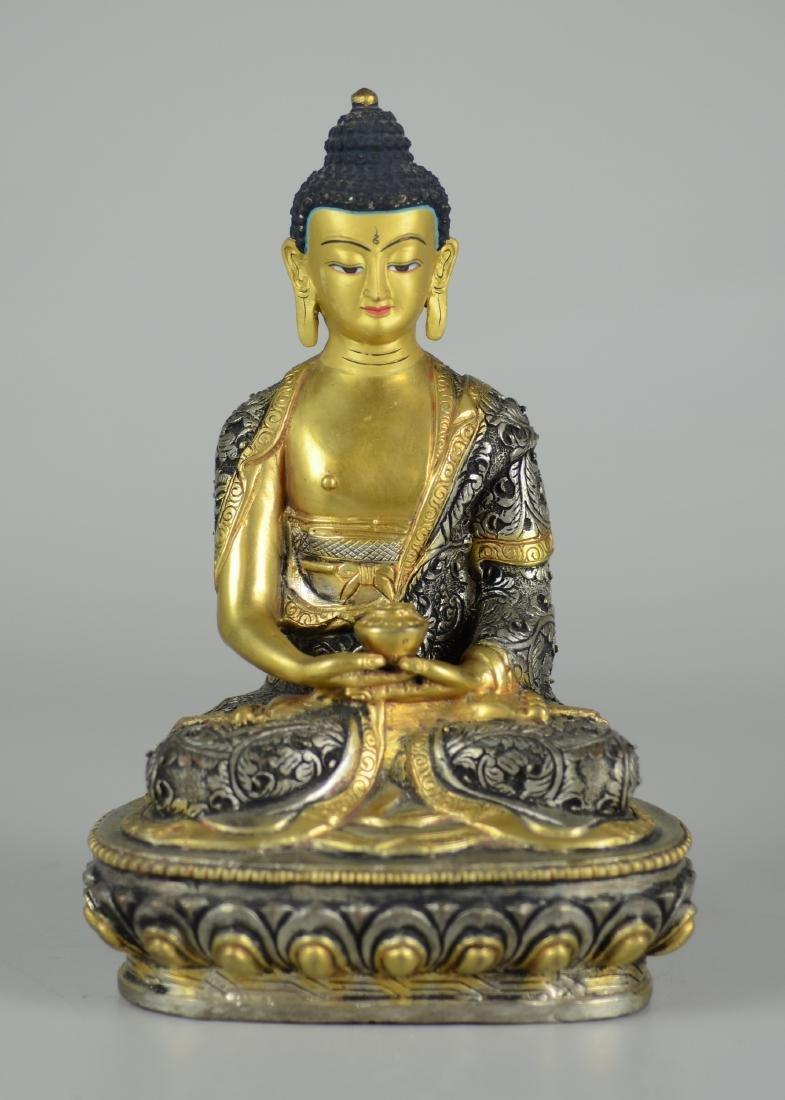 Tibetan silvered and gilt bronze Buddha