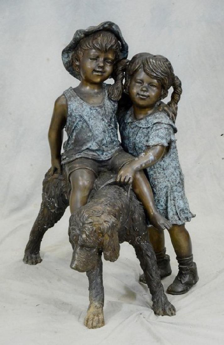 Bronze sculpture, two children with dog