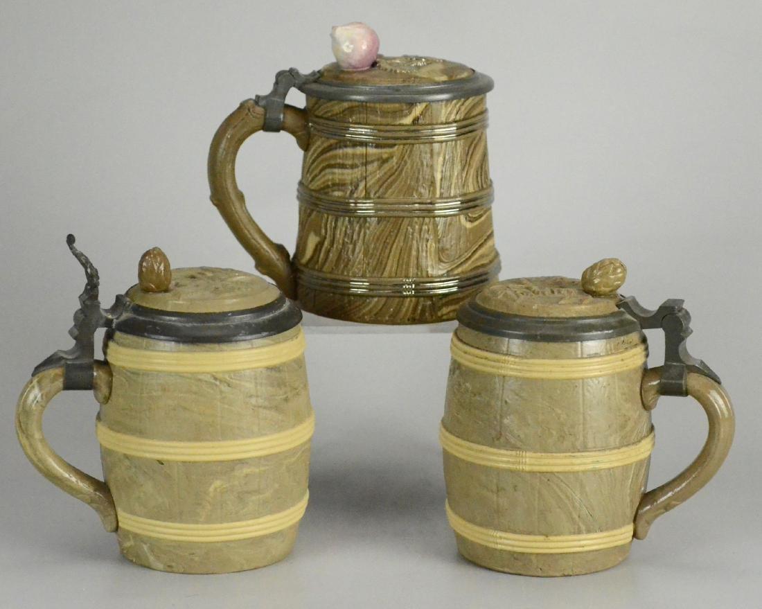 (3) 0.5 L Mettlach Relief Barrel Steins, 468, 675