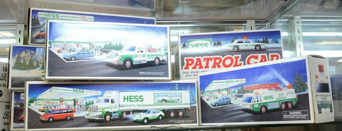 Shelf #61 - (8) Hess toy trucks