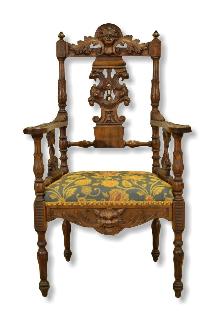 Figural carved walnut Renaissance Revival armchair