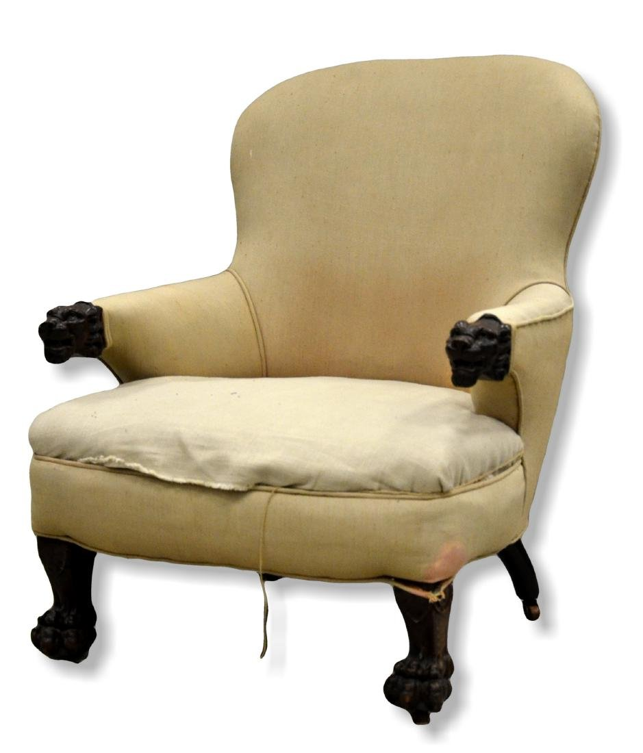 Upholstered Victorian armchair, with lion's head arms