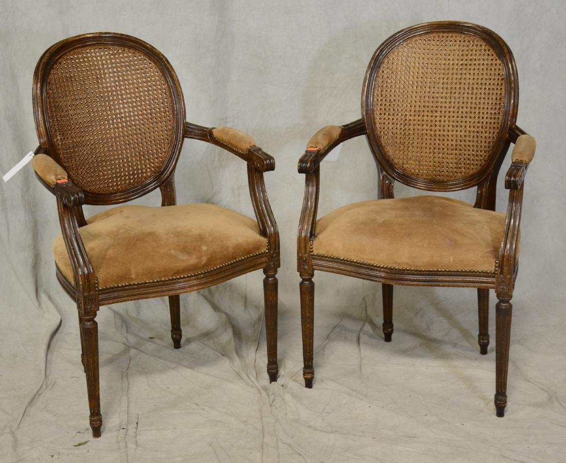 Pair Louis XVI style caned armchairs