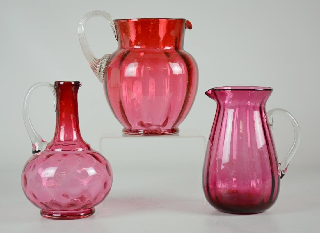 (3) Cranberry & Clear Glass Pitchers
