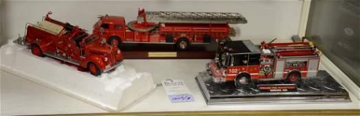 (3) Franklin Mint fire trucks