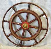 "Brass and wood ship's wheel, 42-1/4""h"