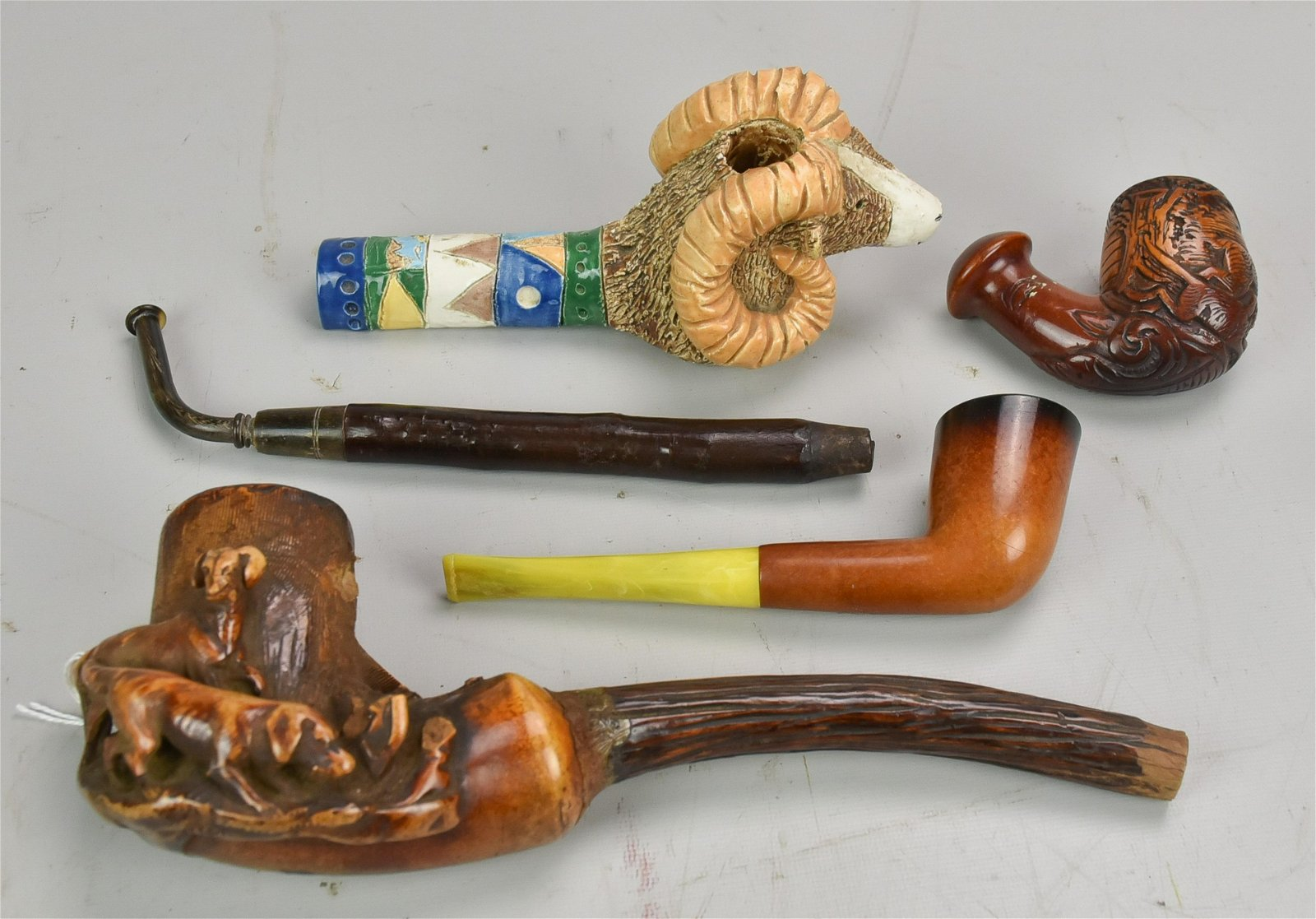 (4) Pipes Including Carved Dogs