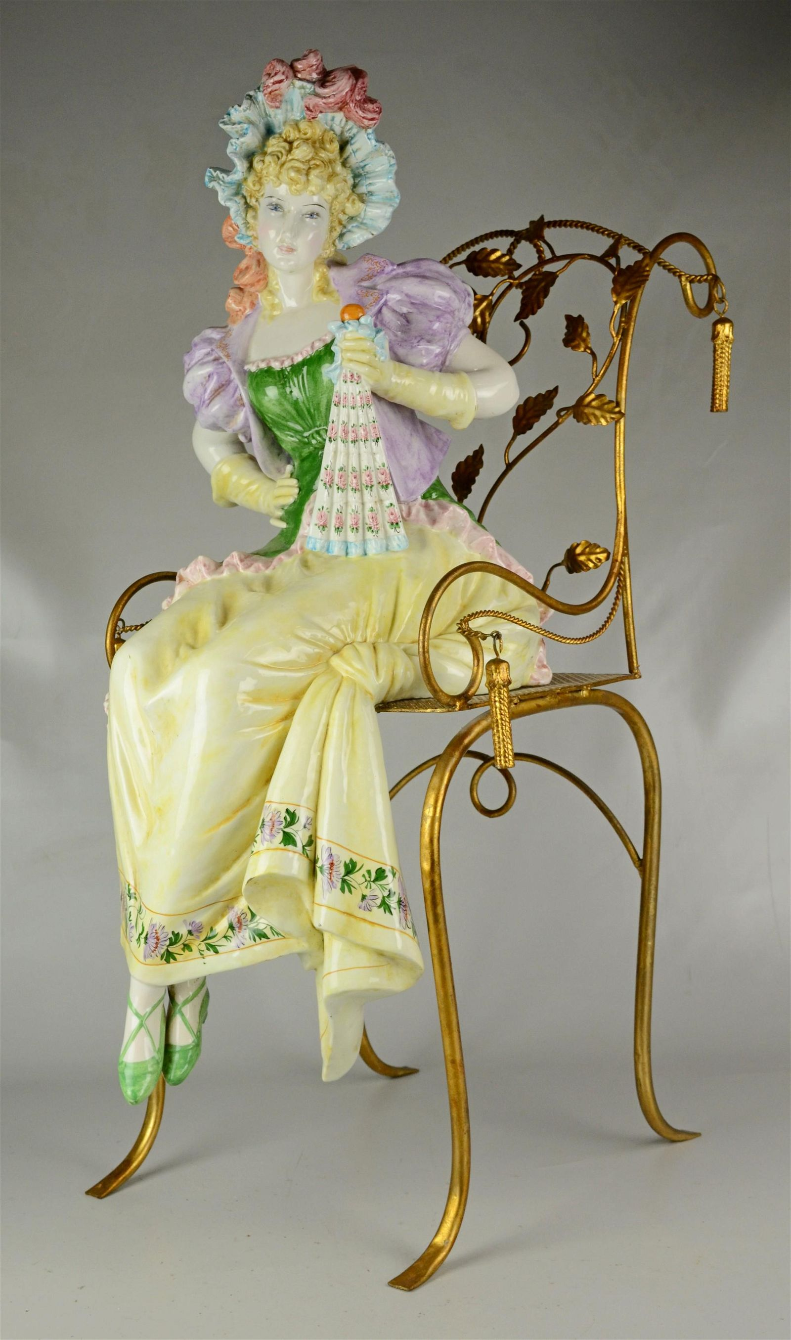 Paris porcelain figure of a fancy lady in ornate chair