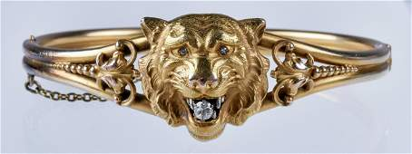 Unmarked 14K YG  lion head bangle bracelet