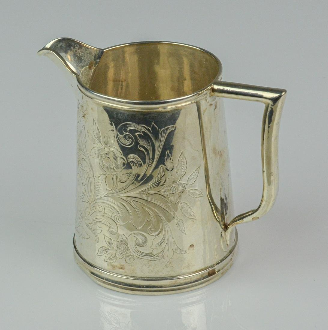 S Kirk & Son sterling 11 OZ engraved cream pitcher