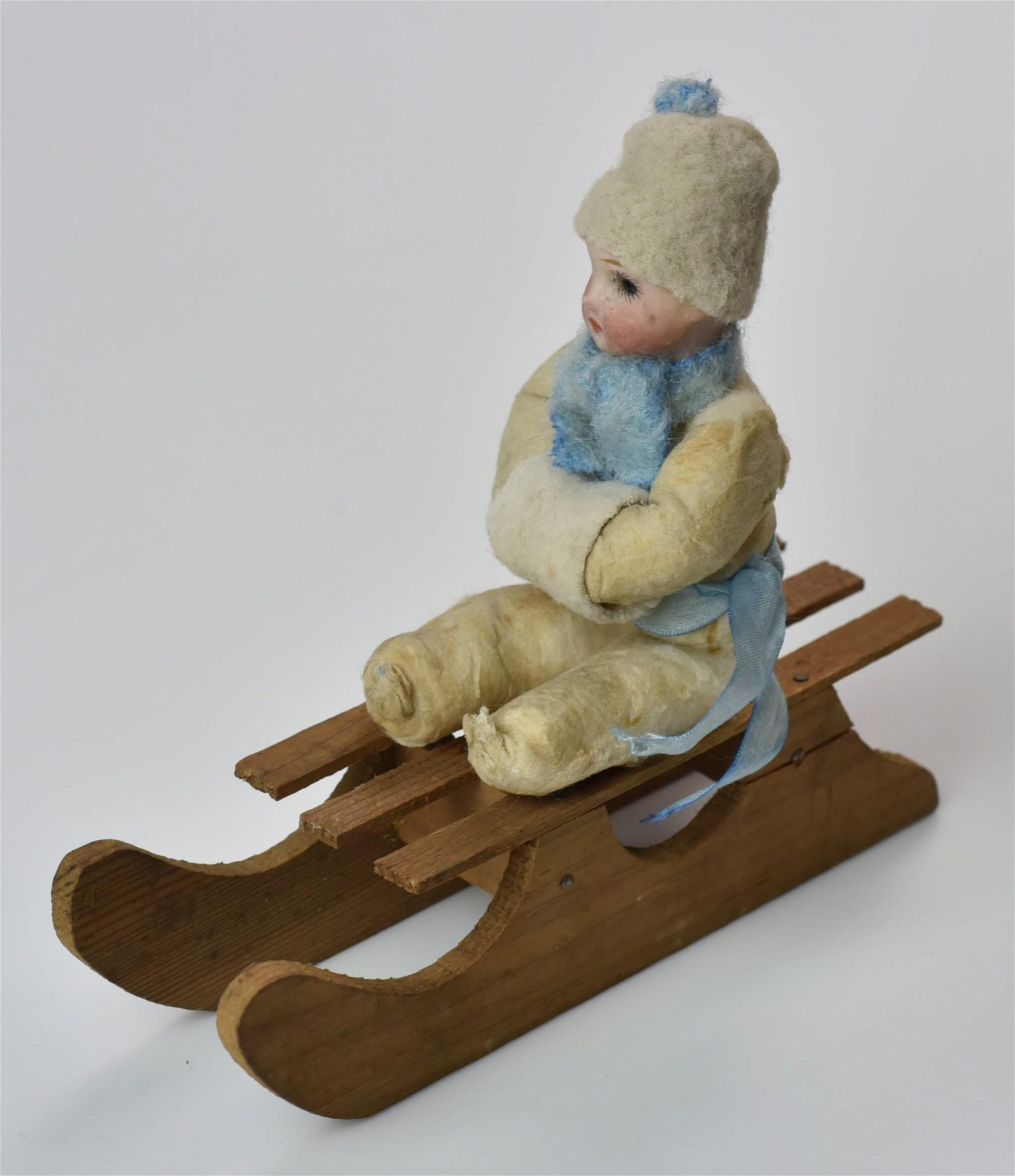 Heubach Child on Wood Sled