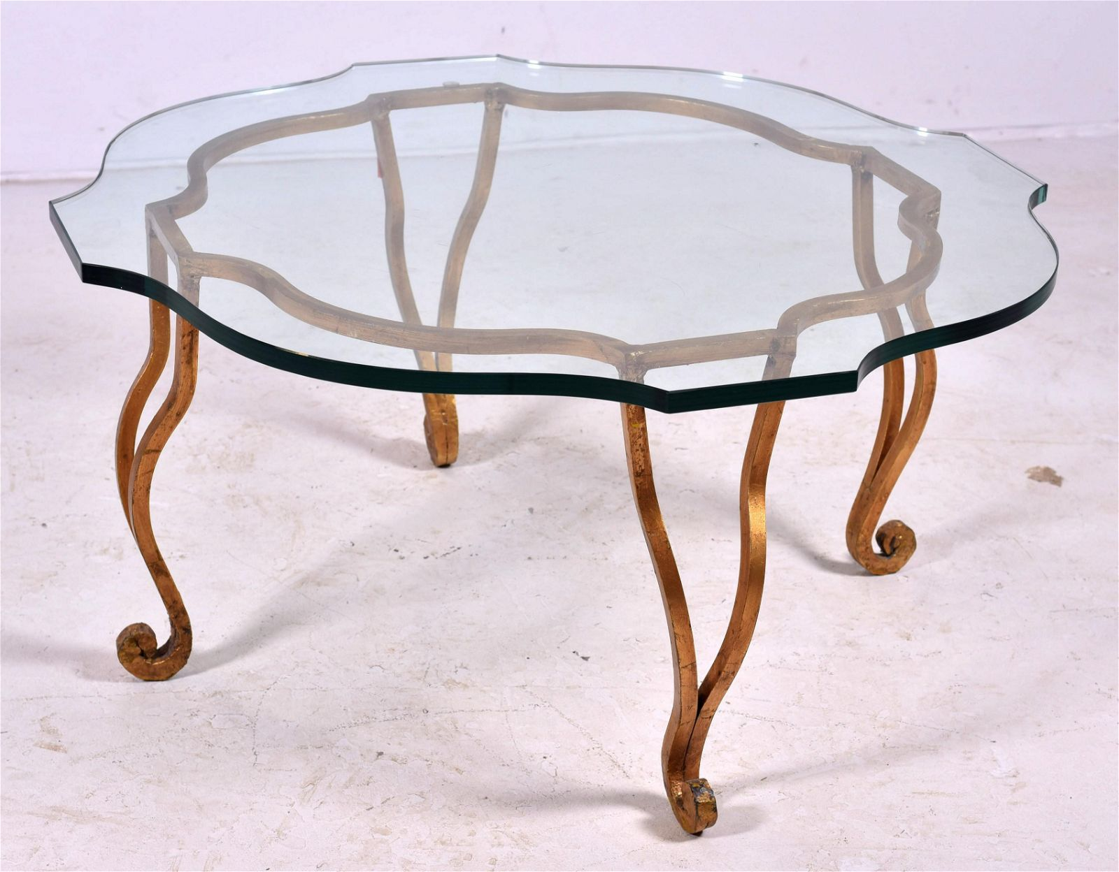 Contemporary glass top gilt leaf metal coffee table