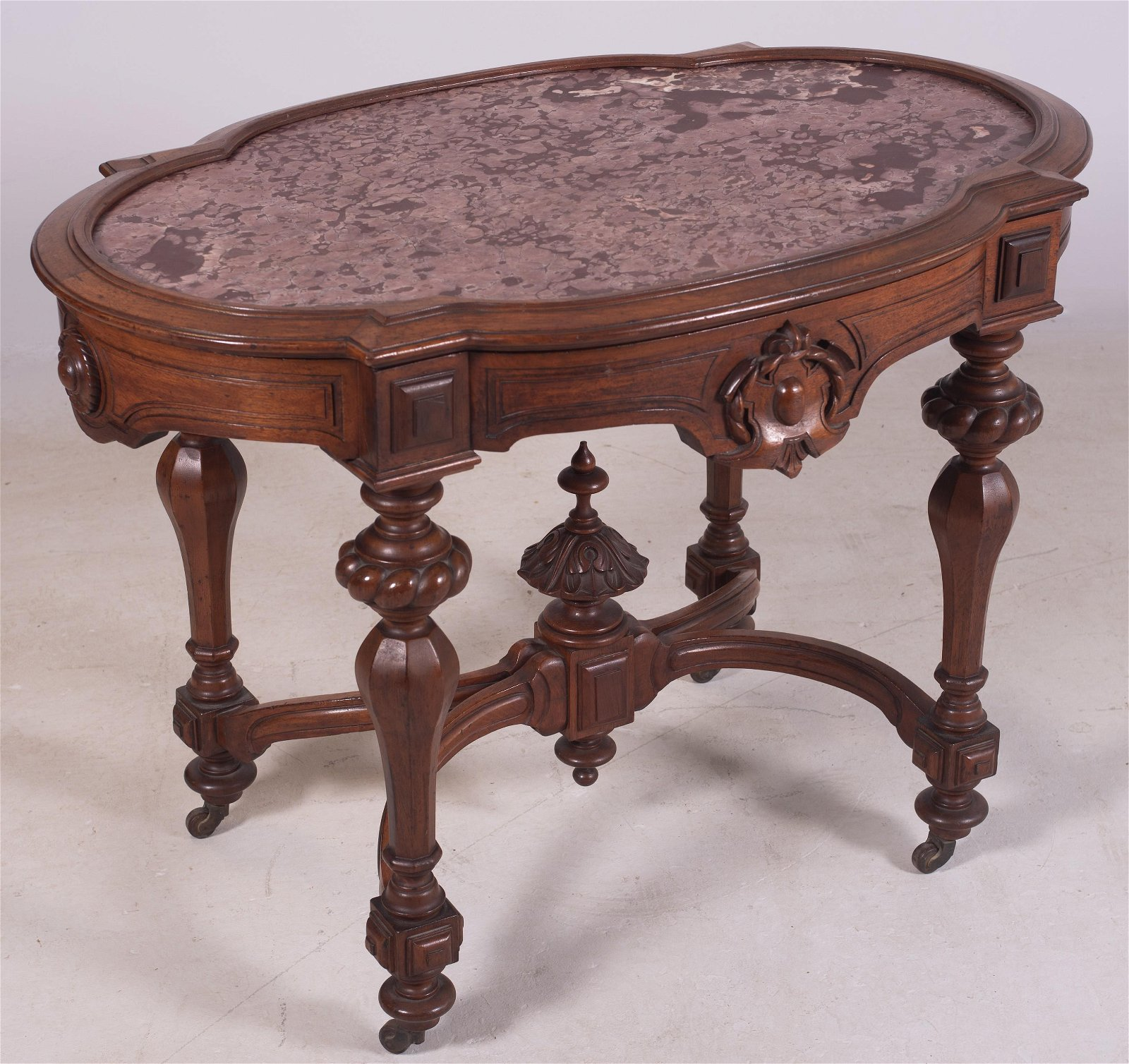 Victorian walnut oval picture frame marble top center