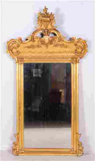 Ornate gilt Victorian wall mirror