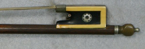 30: Unsigned violin bow, octagonal shaft, ebony frog mo