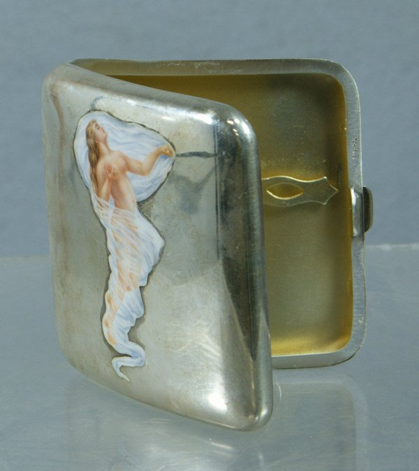 70: Sterling silver cigarette case with enameled nude d