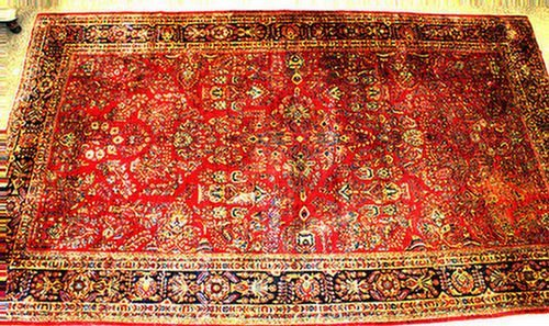 22: 10.4 x 17.7 Sarouk rug, c 1930-40, some scattered w