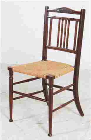 Walnut carved rush seat side chair