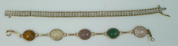 7: 10K YG tennis bracelet with a double row of 1-2 poin