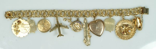 11: 14K YG charm bracelet with 12 charms, locket with d