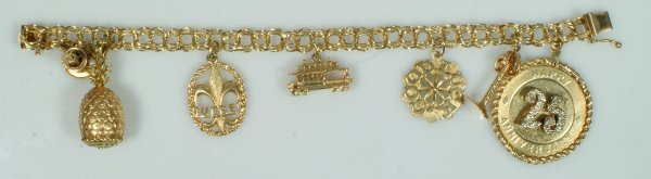 12: 14K YG charm bracelet with 7 charms, palm tree and