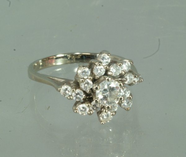 18: 14K WG ladies cocktail ring with center stone appro