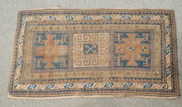 5D: 3.2 x 5.8 Caucasian, worn