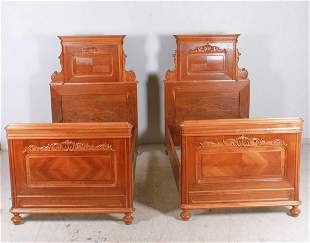 Pair Victorian twin size walnut carved beds