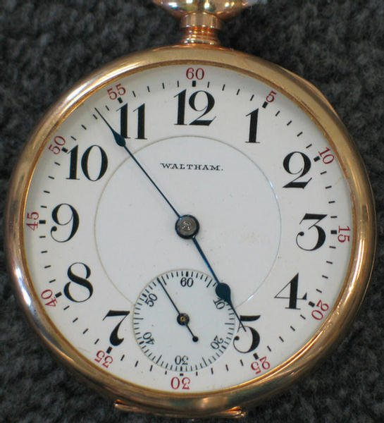 "1017: Waltham 14K yg open faced pocket watch and 9.5"" 1"