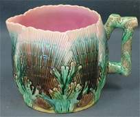 265: Etruscan majolica shell and seaweed pitcher