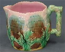 271: Etruscan majolica shell and seaweed pitcher