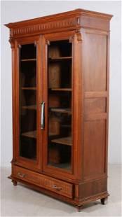 Victorian style walnut carved 2-door bookcase