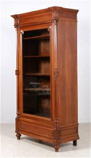 Victorian style one door carved walnut bookcase