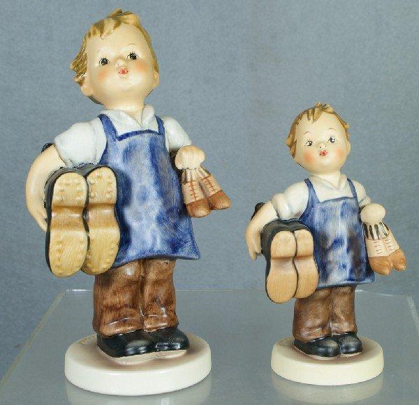"""24: 2 Hummel figurines: Boots - 1433/I, 6 1/2"""" tall; Bo"""