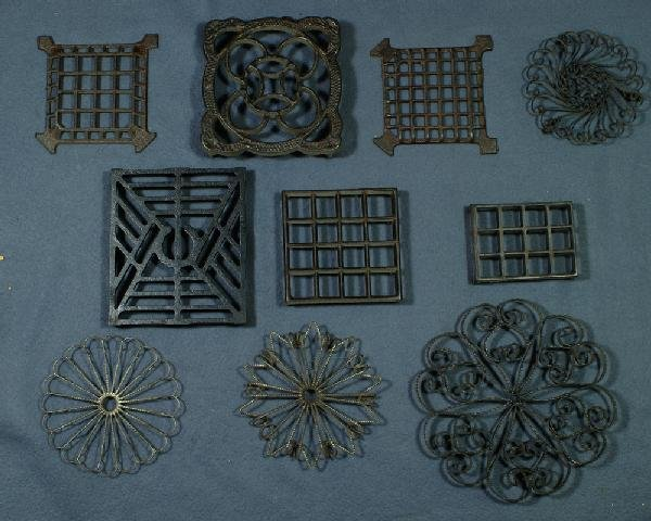 2: Lot of 6 square cast iron trivets and 4 round wrough